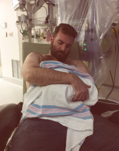 New father holds son.